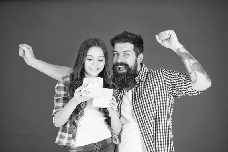 Family celebration. Man bearded father and cute little girl daughter red background. Celebrate fathers day. Family royalty free stock images