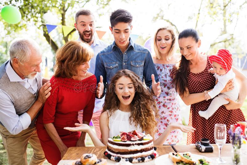 Family celebration or a garden party outside in the backyard. royalty free stock photo