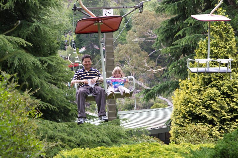Family chair lift fun. A father and daughter enjoying a ride on a chair lift at Cateract Gorge, Northern Tasmania royalty free stock photo