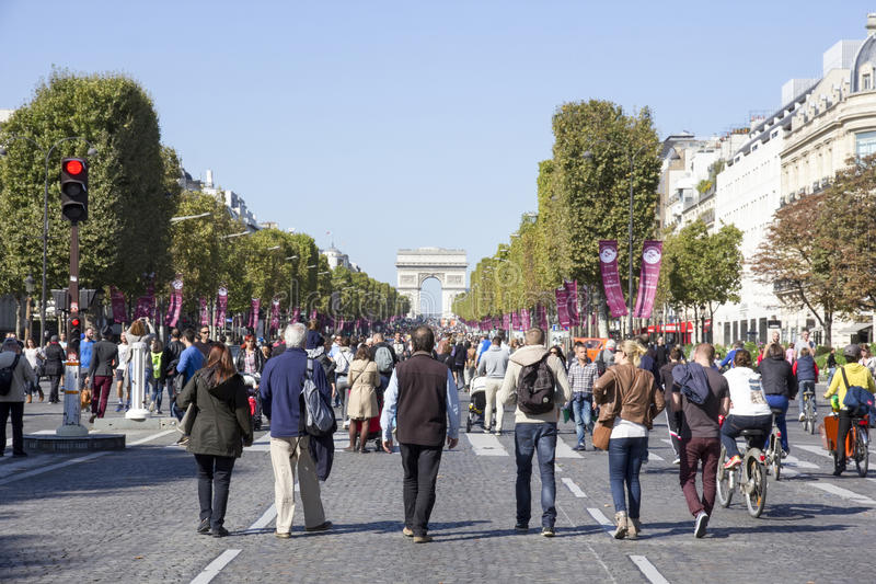 Family on Champs Elysees at Paris car free day stock photo