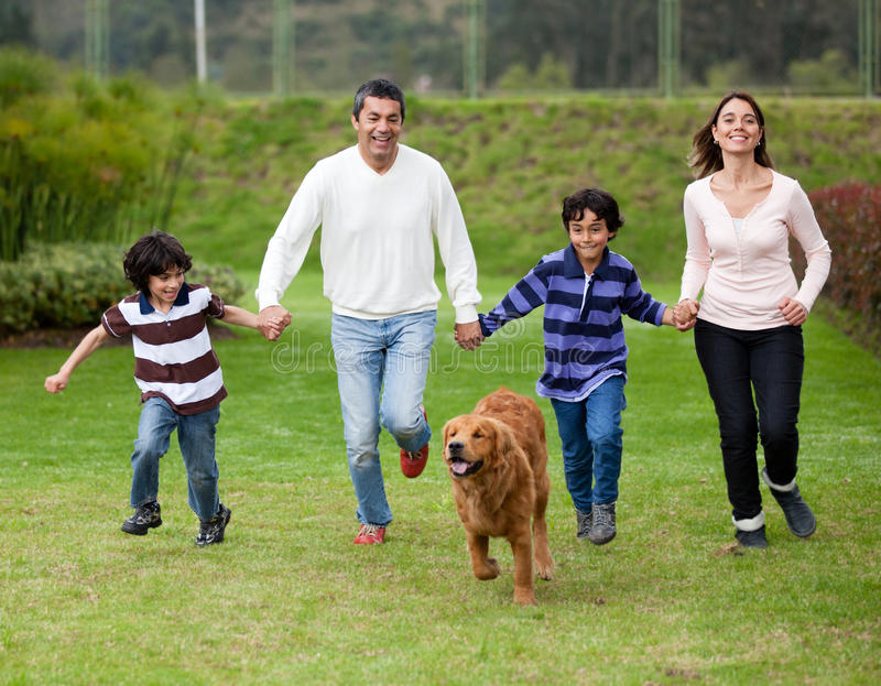 Download Family chasing a dog stock image. Image of boys, kids - 25041735