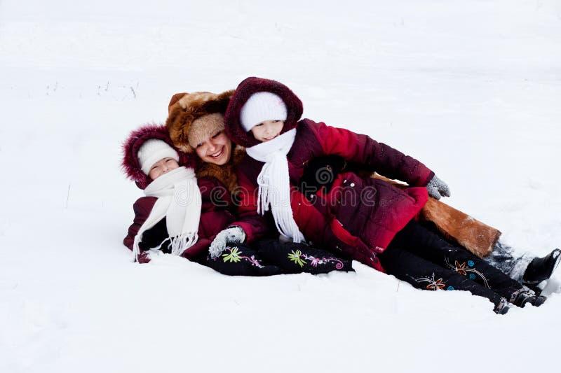 Family Cheerfully Play To Snow Stock Photos