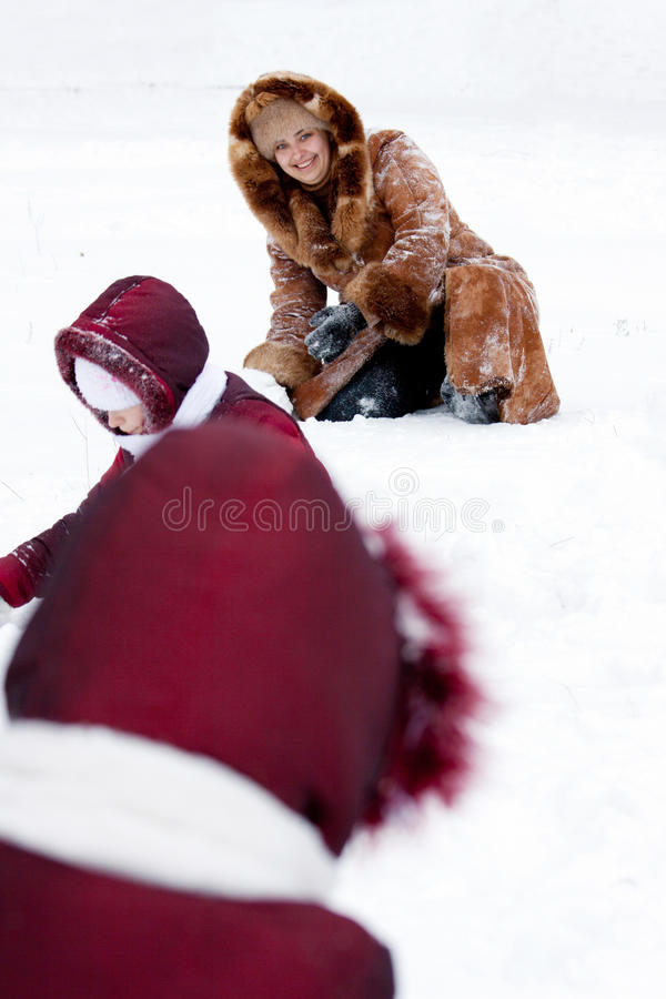 Download Family Cheerfully Play To Snow Stock Image - Image: 22691441