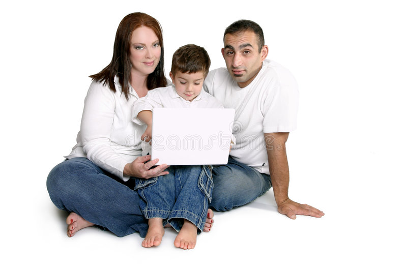 Family with child on computer royalty free stock photos
