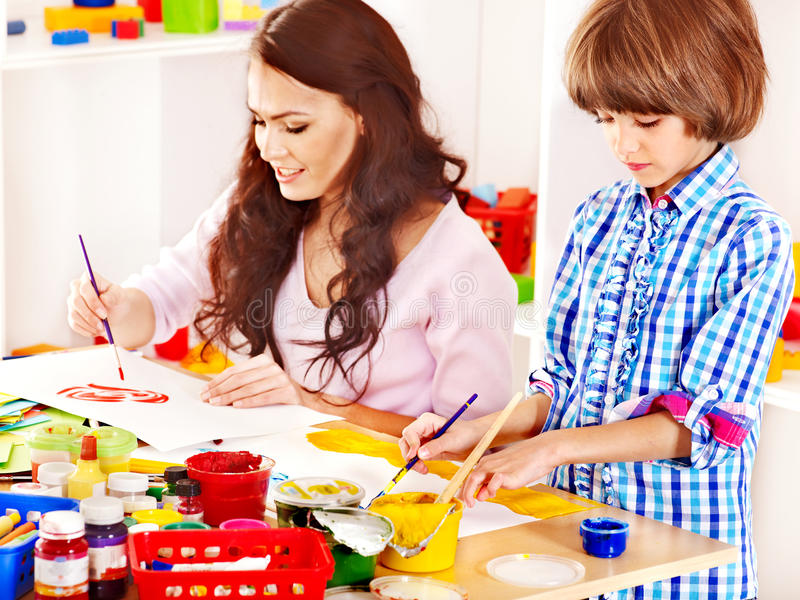 Family with child playing bricks. royalty free stock image