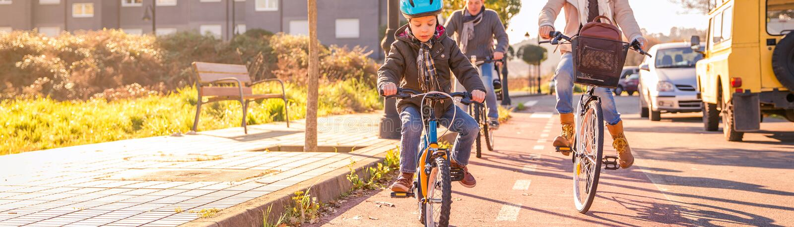 Family with child riding bicycles in the city royalty free stock photos