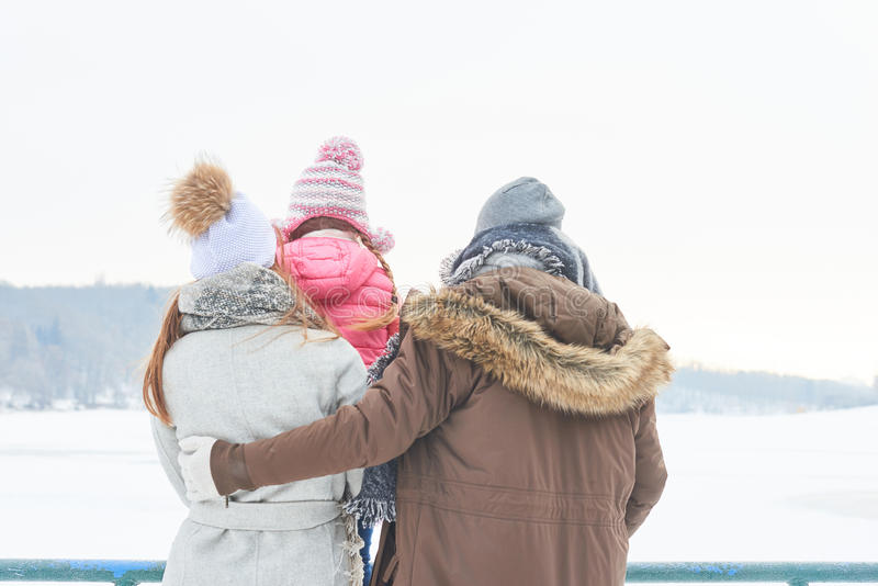 Family with child in winter holiday trip stock photo