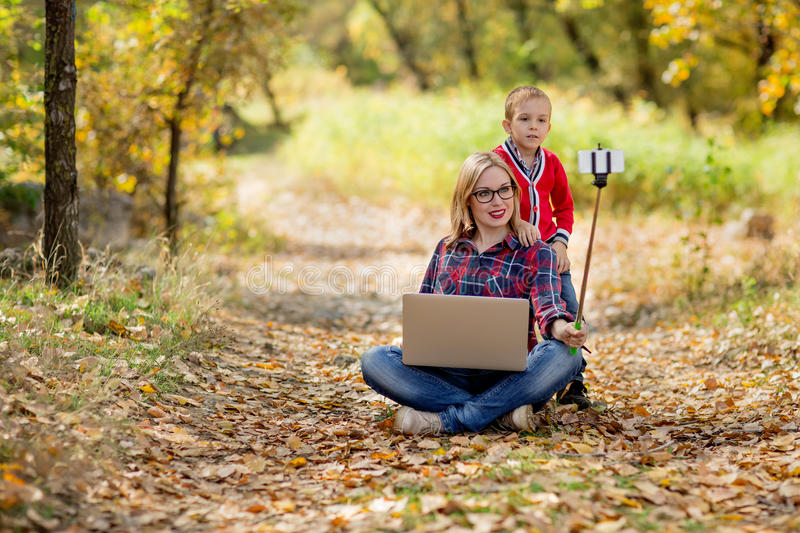 Happy little girl taking a selfie-stick with smartphone and mono royalty free stock photo