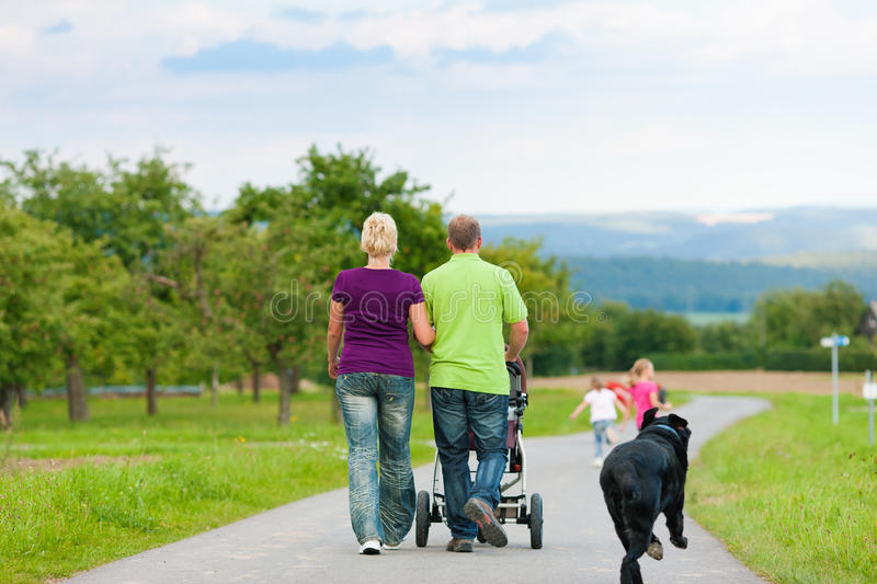 Family With Children And Dog Having Walk Royalty Free Stock Image