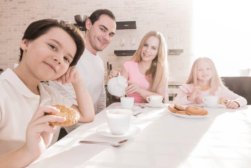 Family with children having breakfast stock photos