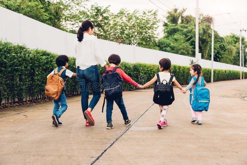 Family children kid son girl and boy kindergarten walking going royalty free stock images