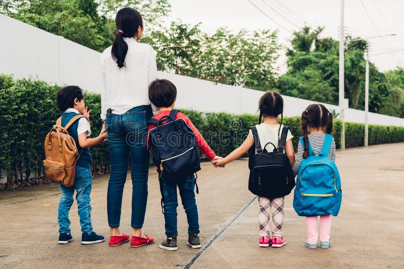 Family children kid son girl and boy kindergarten walking going to school royalty free stock photos
