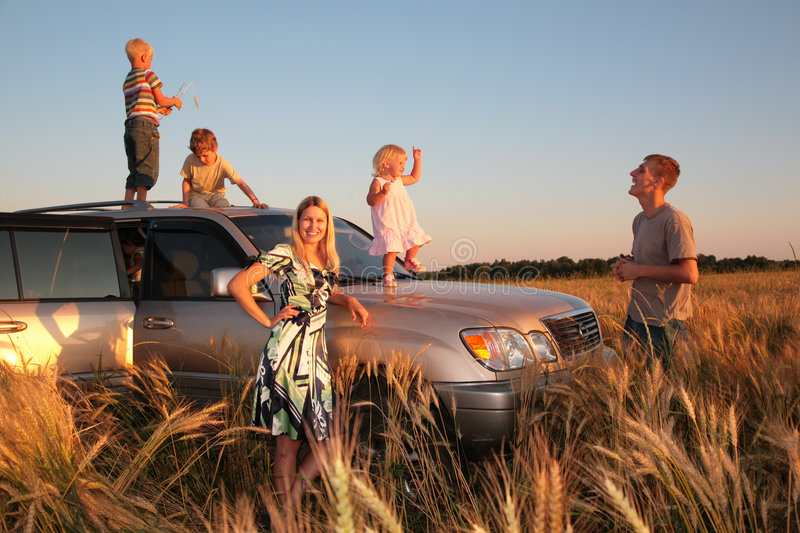 Family with children on offroad car stock photos