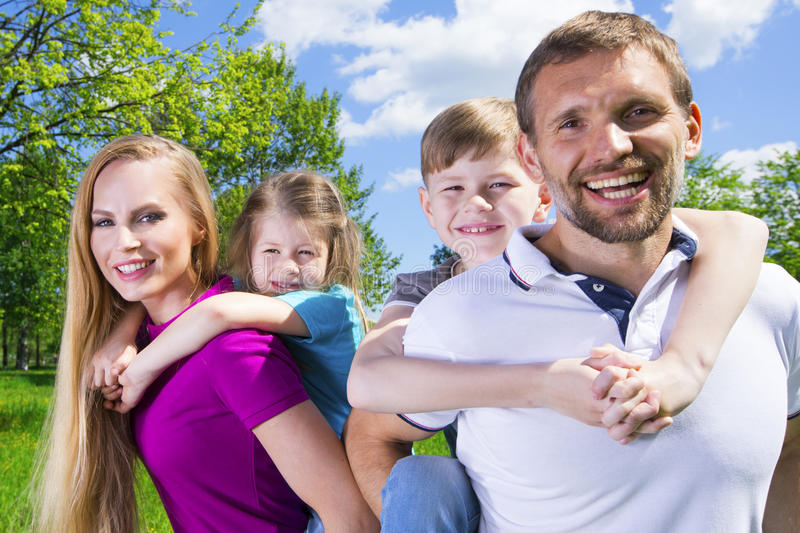 Family with children in park stock image