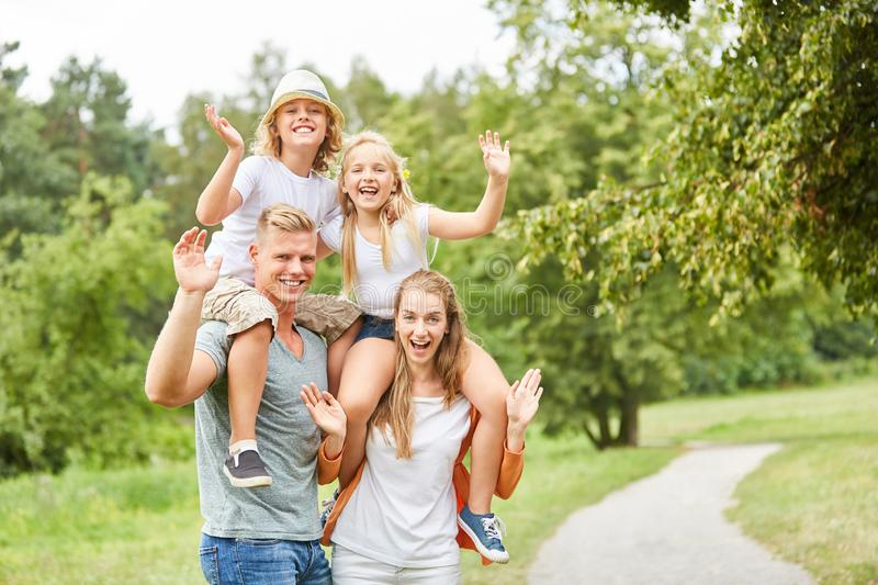Family and children are waving happily stock photo