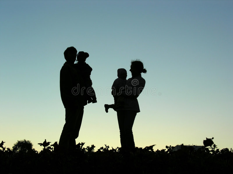 Family with children silhouette royalty free stock photos