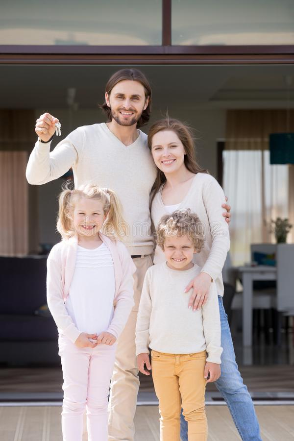 Family with children standing on terrace of new house royalty free stock image