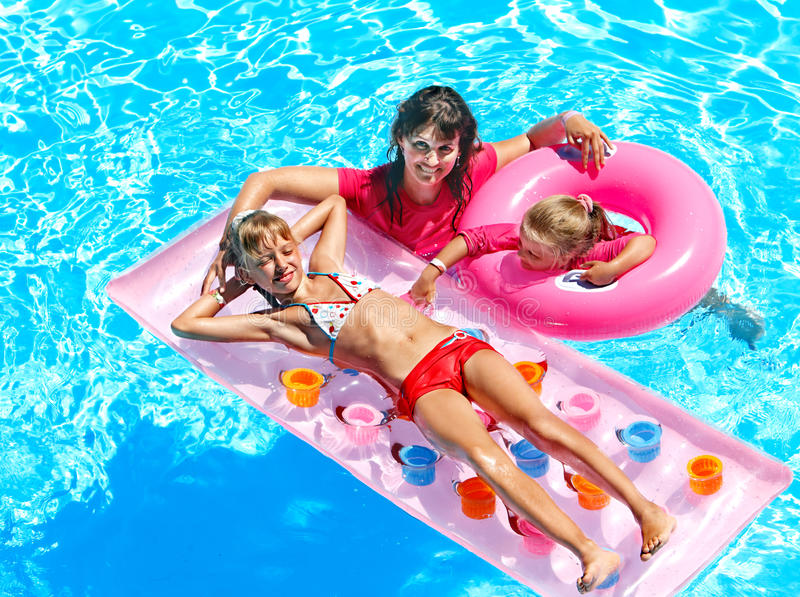 Family In Swimming Pool. Stock Photos