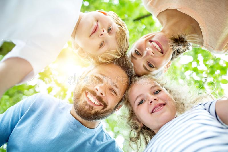 Family and children together in teamwork stock image