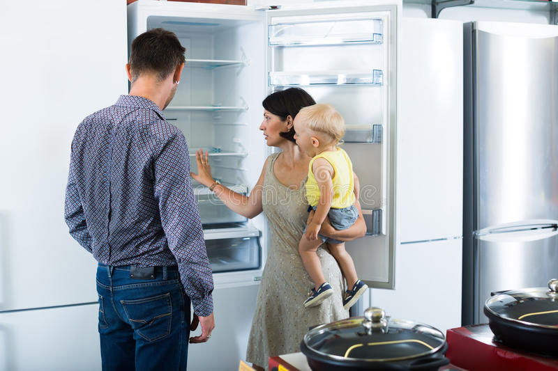 Family choosing new freezer in store stock photo