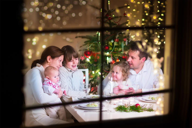 Family at Christmas dinner royalty free stock photography
