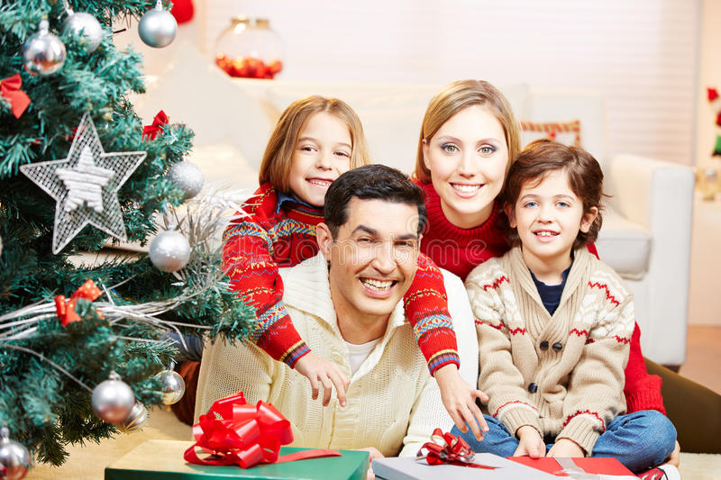 Family at christmas with gifts and tree stock photo