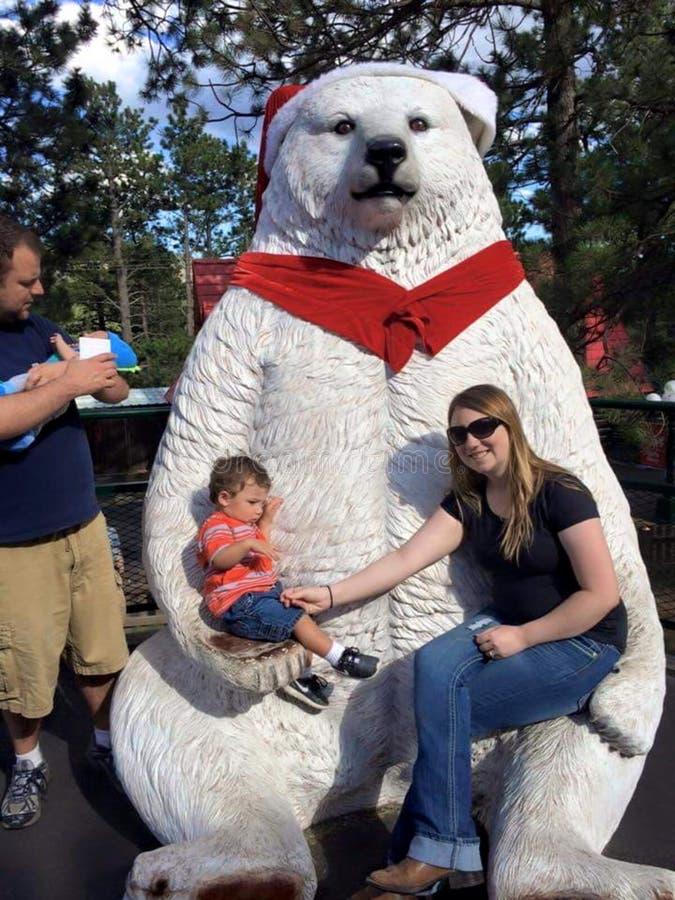 Family with Christmas polar bear royalty free stock photography