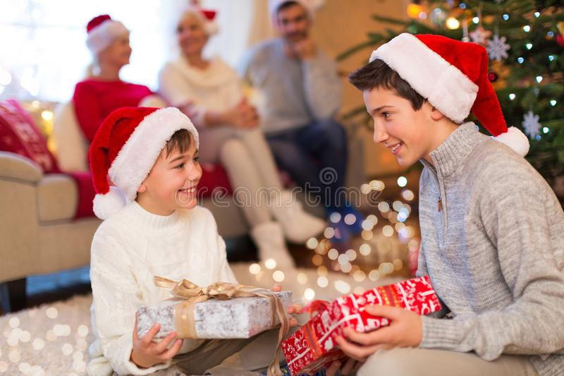 Family at Christmas. Smiling family at Christmas time opening presents stock photography