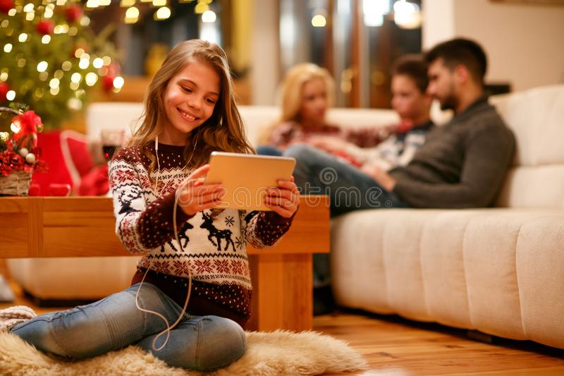 Family, Christmas, technology, music concept - little girl with stock photography
