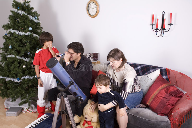 Family christmas time. Happy family having fun and opening gift at christmas time royalty free stock images