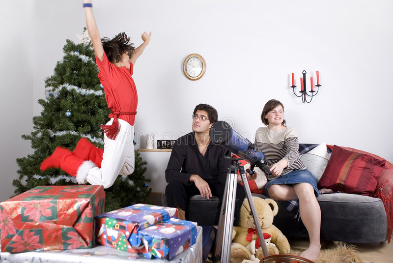 Family christmas time. Happy family having fun and opening gift at christmas time royalty free stock photo