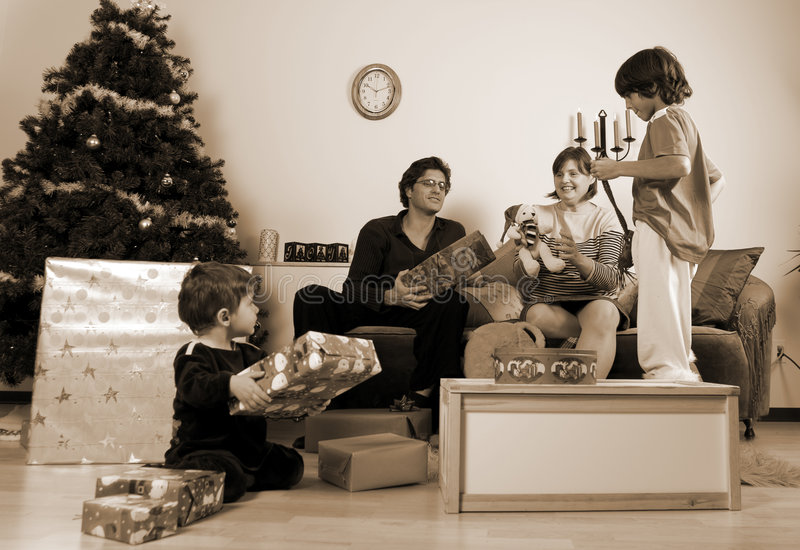 Family christmas time. Happy family having fun and opening gift at christmas time stock images