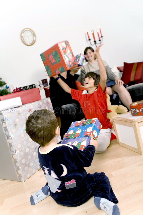 Family christmas time. Happy family having fun and opening gift at christmas time stock photos