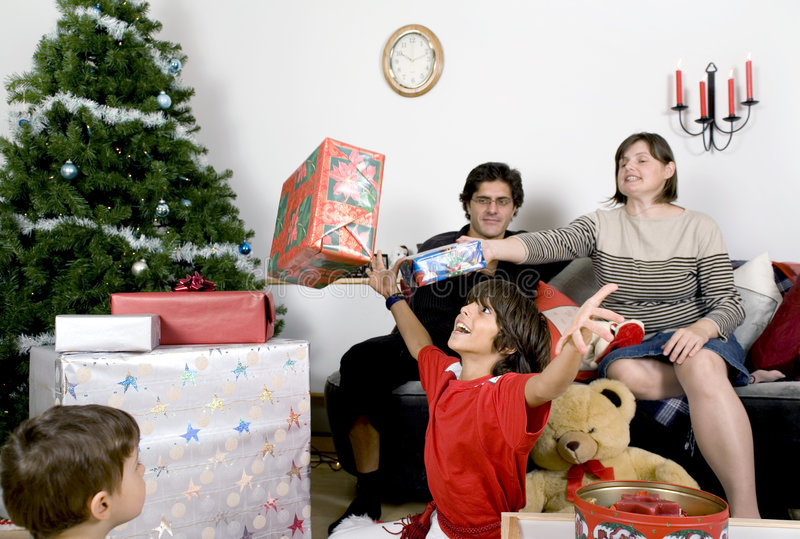Family christmas time. Happy family having fun and opening gift at christmas time stock photography