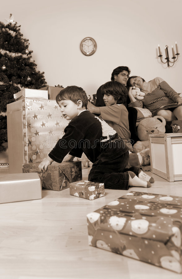 Family christmas time. Happy family having fun and opening gift at christmas time royalty free stock photography