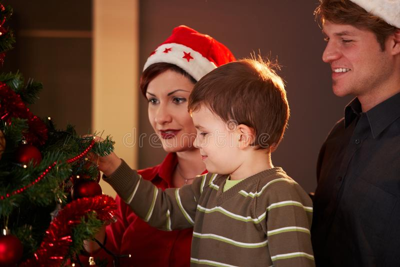 Family At Christmas Tree Royalty Free Stock Images