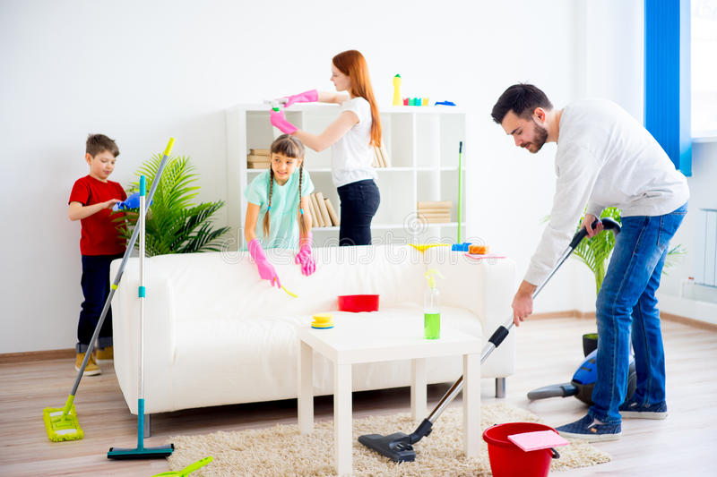 Family cleaning house. Happy family of four is cleaning their house royalty free stock photo