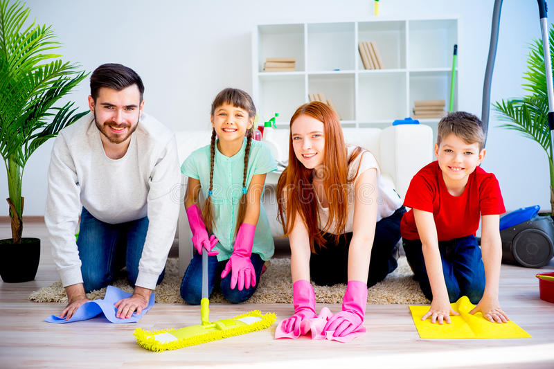 Family cleaning house. Happy family of four is cleaning their house stock photos
