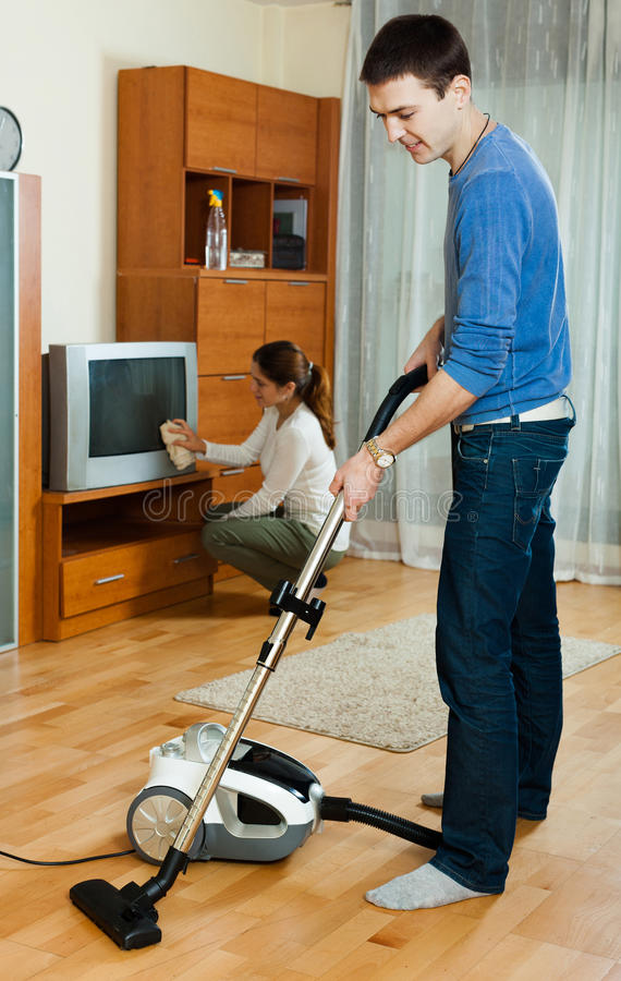 Family  Cleaning With Vacuum Cleaner Stock Photo