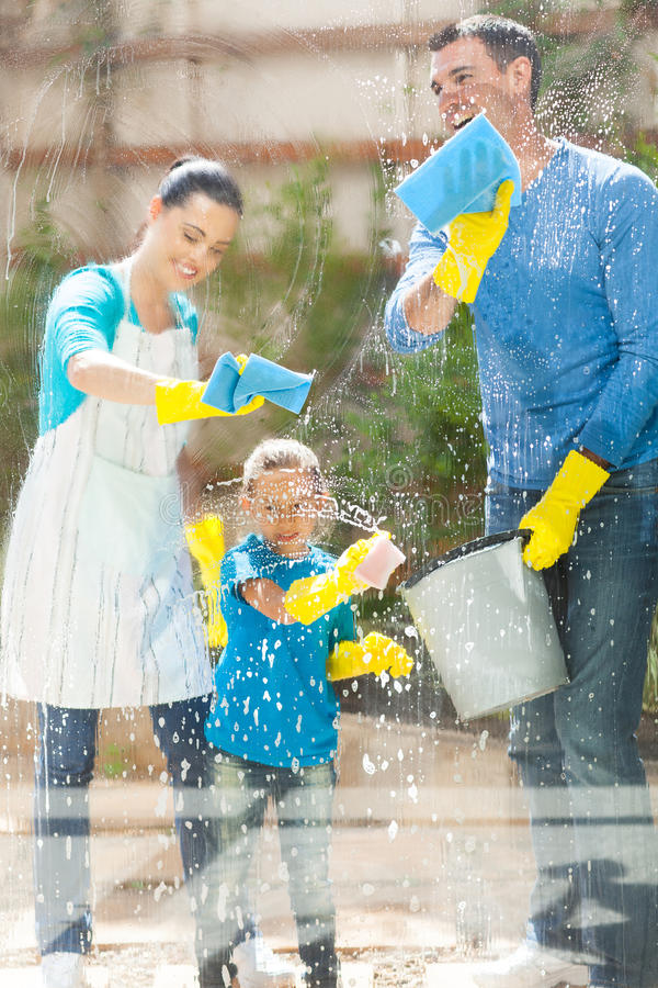 Family cleaning window royalty free stock photos