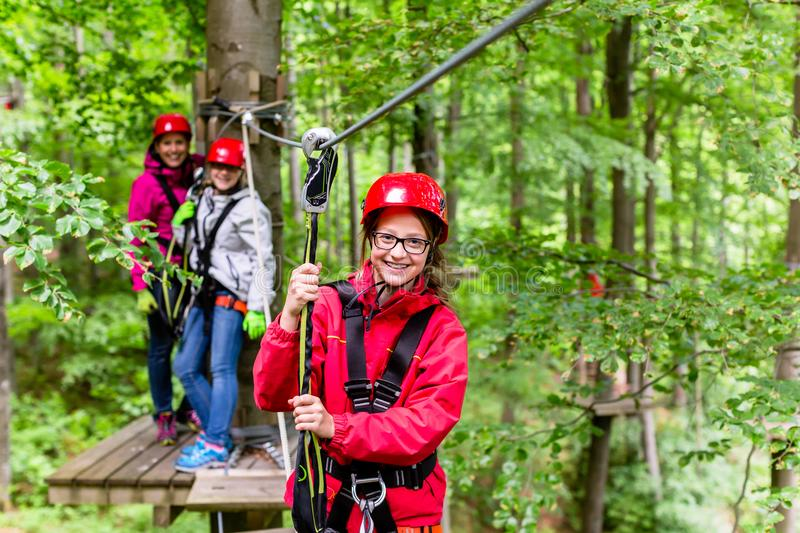 Family climbing in high rope course. Outdoors stock photos
