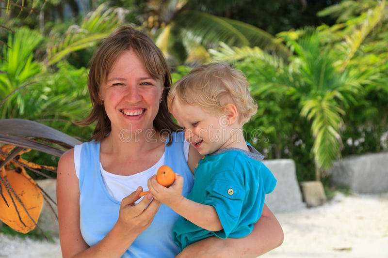 Family with coconut stock photography