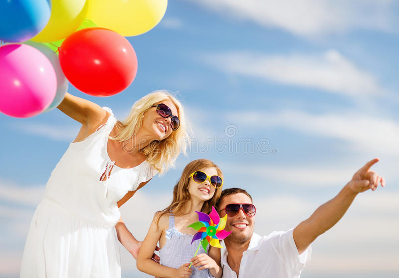 Family with colorful balloons royalty free stock photography