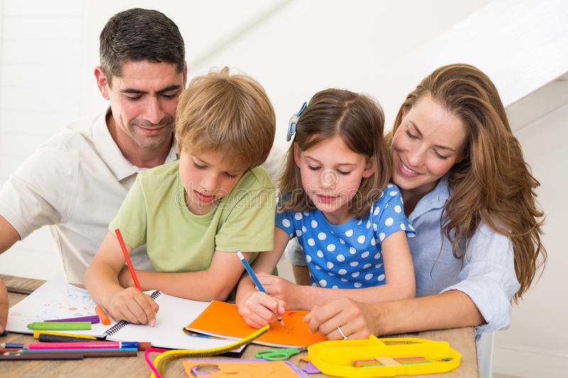 Family coloring together at home stock photography
