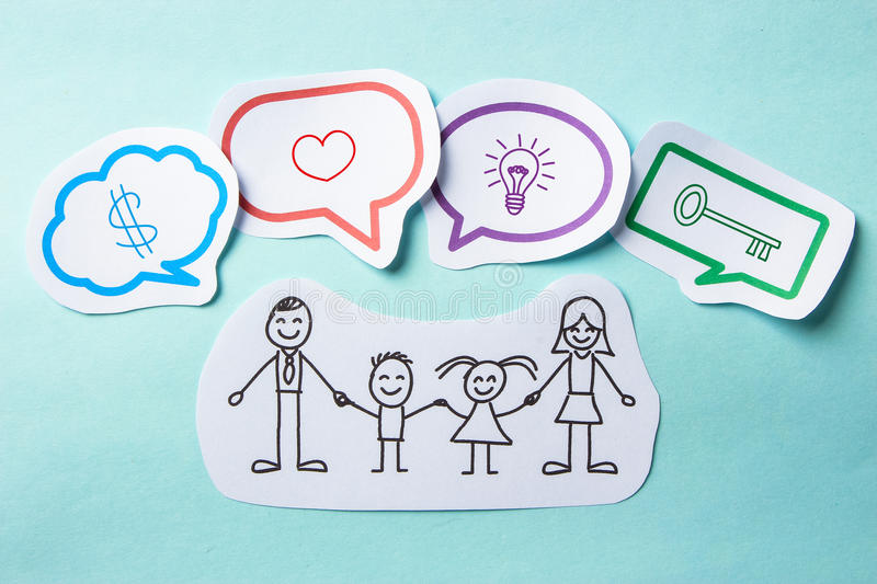 Family concept. Happy paper family with speech bubbles of Success concept on the blue background stock images