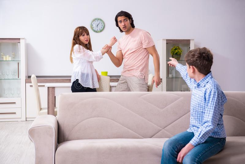Family conflict with husband and wife and child stock photo