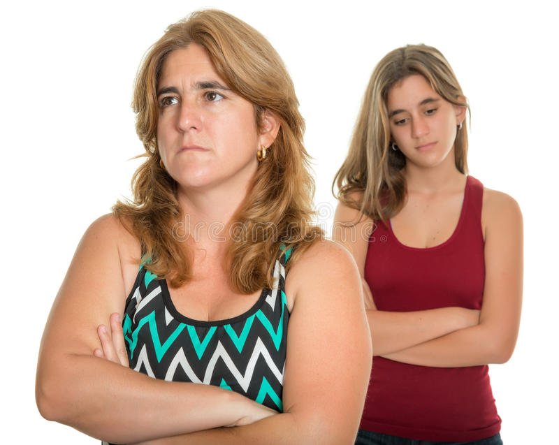 Family conflict - Sad mother and her teen daughter. Family problems, Teenager conflict - Sad and worried mother and her teenage daughter - Isolated on white royalty free stock image