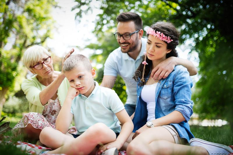 Family consoling little stubborn child and managing emotions. Outdoor royalty free stock photos