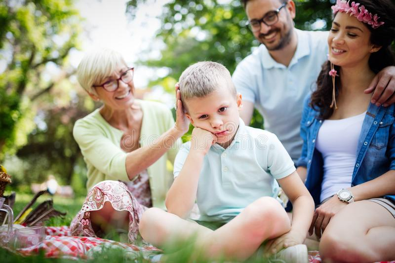 Family consoling little stubborn child and managing emotions. Outdoor royalty free stock photo