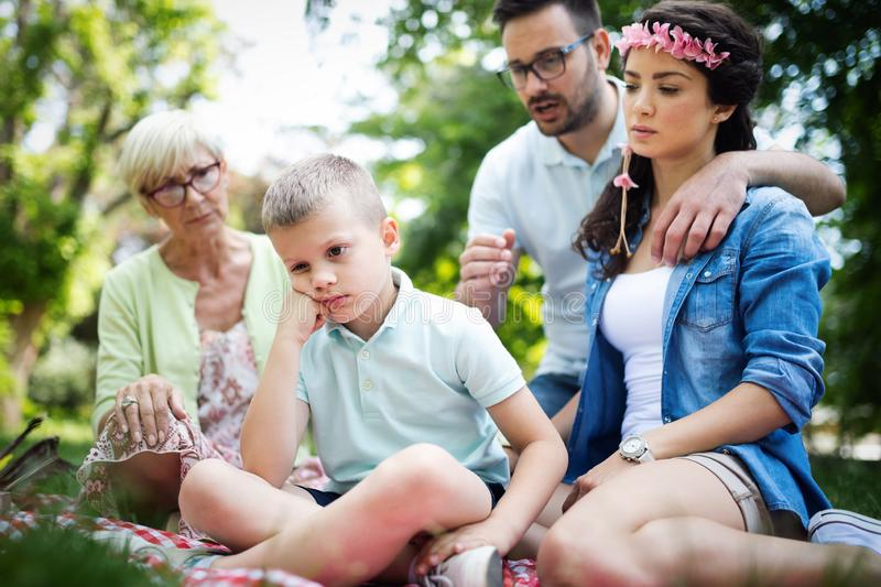 Family consoling little stubborn child and managing emotions. Outdoor royalty free stock photography